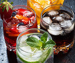 iced fruit drinks on a dark background, top view, vertical